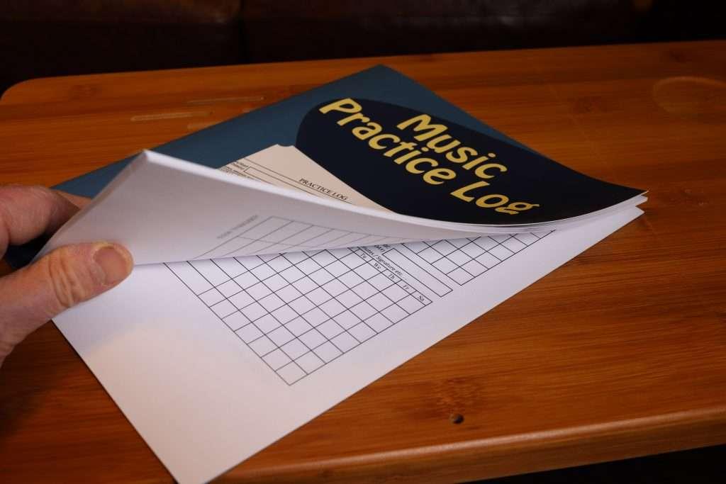 Music Practice Log on a desk