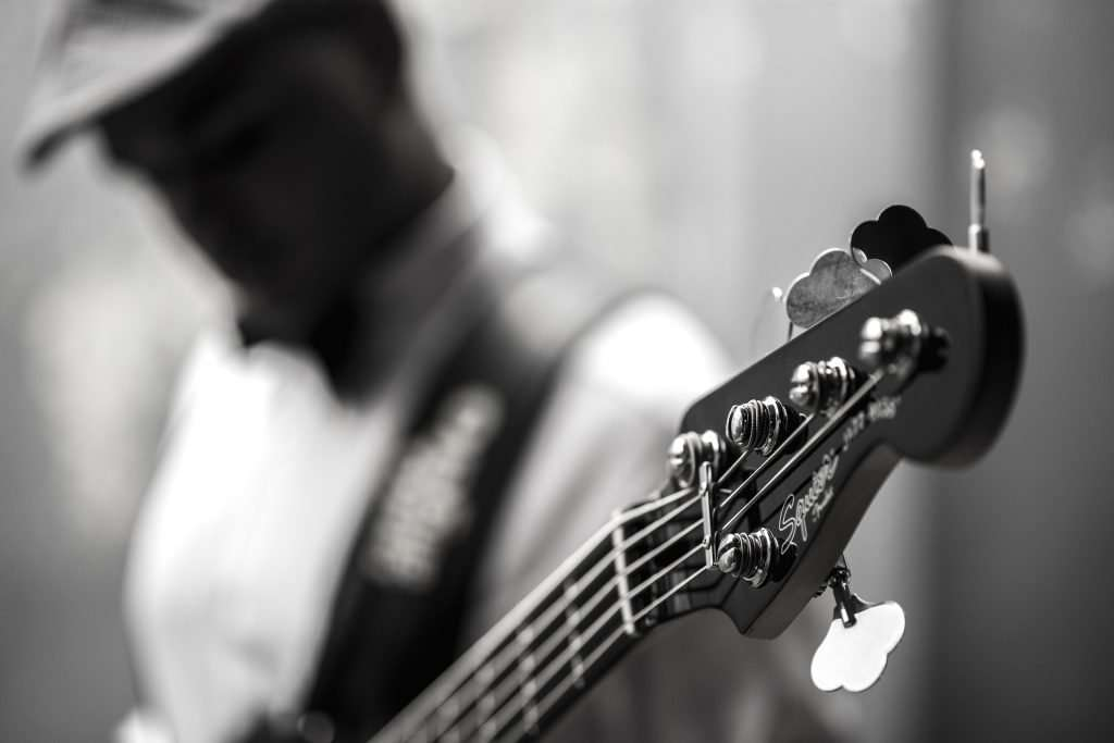 Person playing 5-String Bass Guitar
