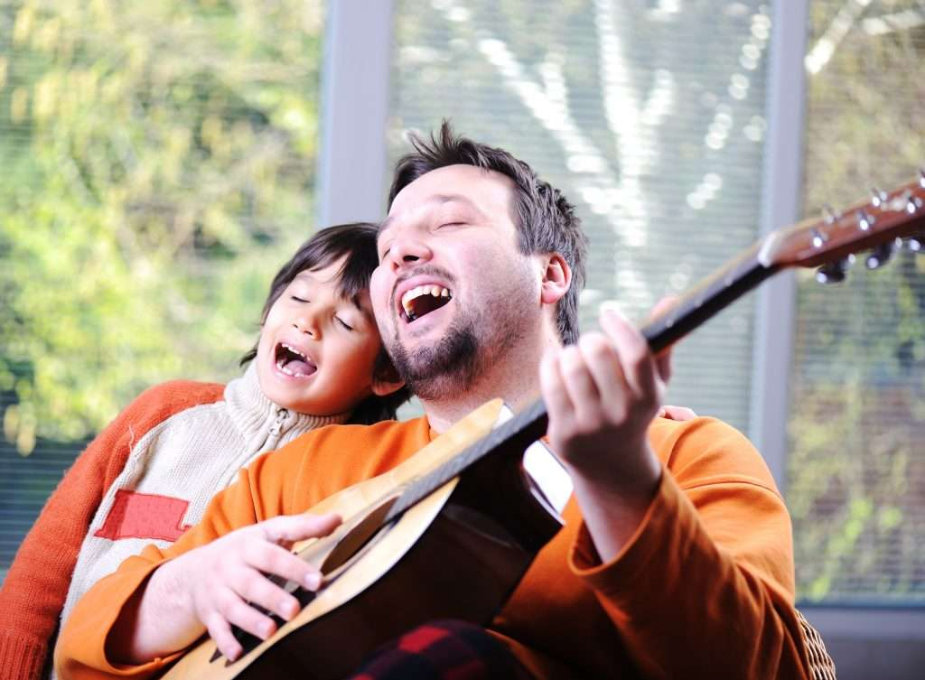 """Dad and son singing """"Joy to the World"""""""
