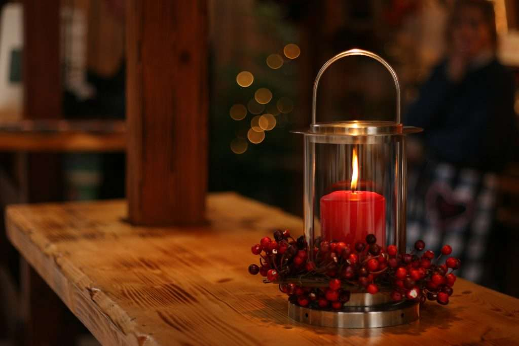 Christmas candle creating some atmosphere for singing The First Noel