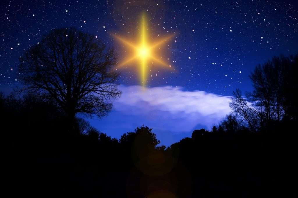 O Come O Come Emmanual - picture of a Christmas star in the sky