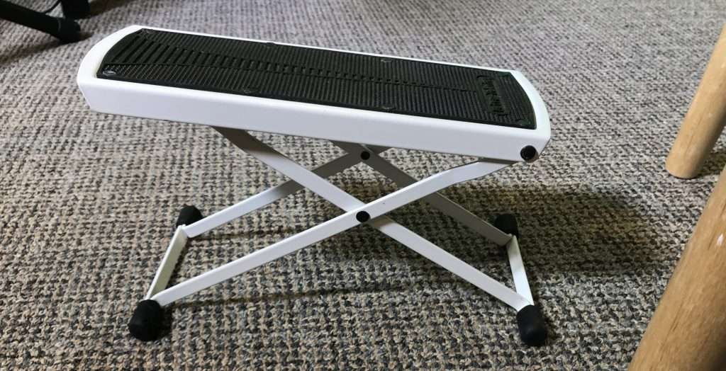 Guitar foot stool or foot rest used to raise one leg for playing guitar