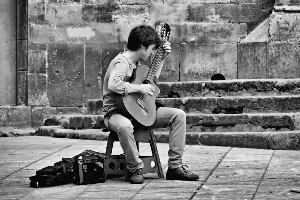 Man playing Romanza on Guitar